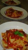 hand-built ravioli in tomato sauce